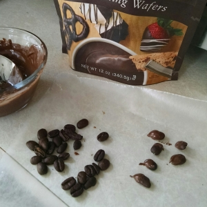 Just melt the chocolate, dip the beans, and cool on a sheet of waxed paper.
